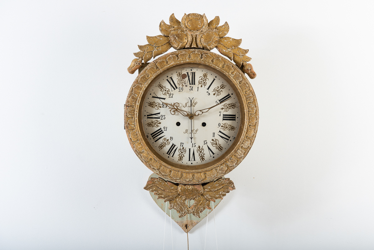 Folk art wall clock