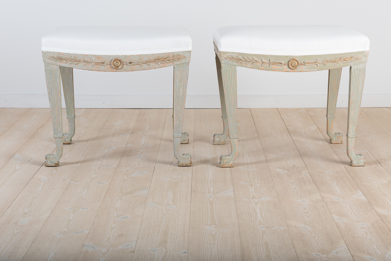 A pair of Swedish empire tabourets