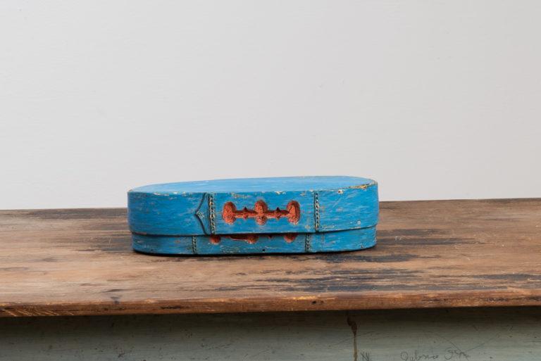 Oval Swedish folk art box with original bluish paint