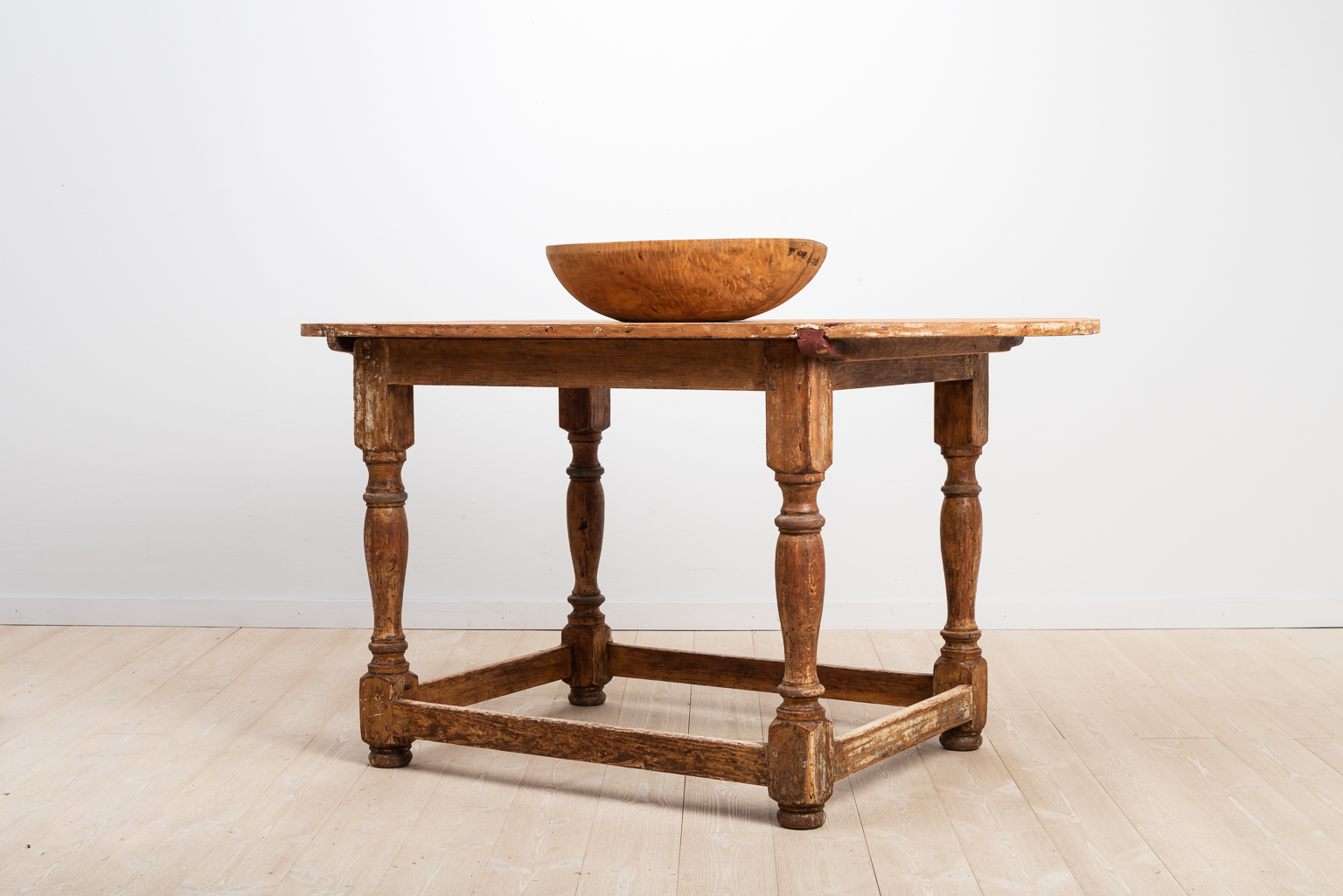 Swedish baroque table in pine with an oval table top.