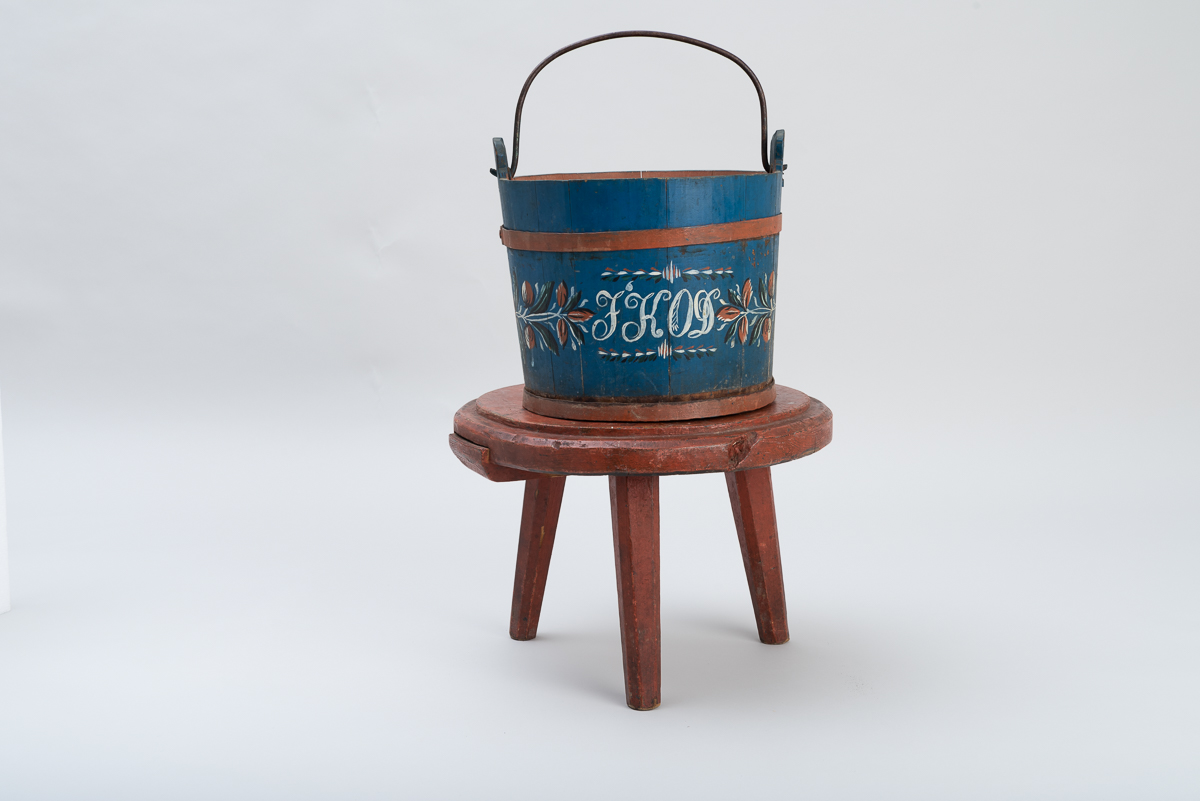 Folk art wooden bucket with decorative painting all around