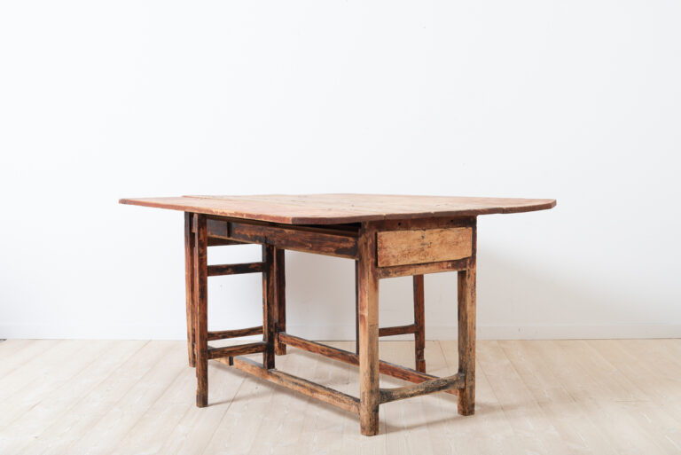 Folk art drop leaf table with drawer. Unusual model a long mid section and short drop leafs