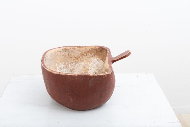 Folk art wooden bowl with an unusual organic shape