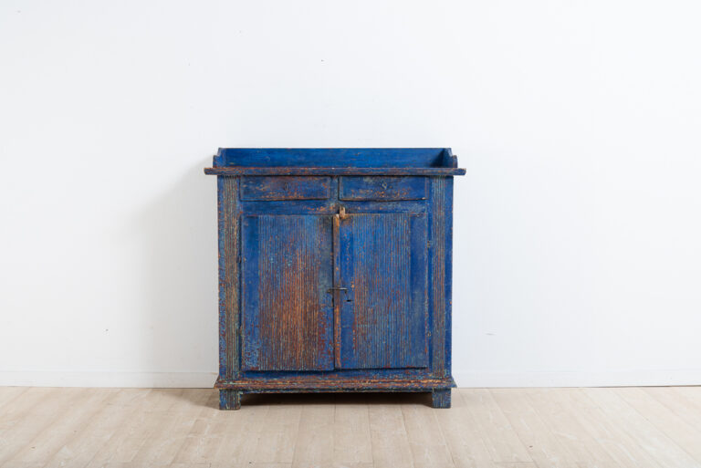 Provincial gustavian sideboard with fluted decor. Good patina all over and old historic blue paint. The lock on the door is missing and replaced