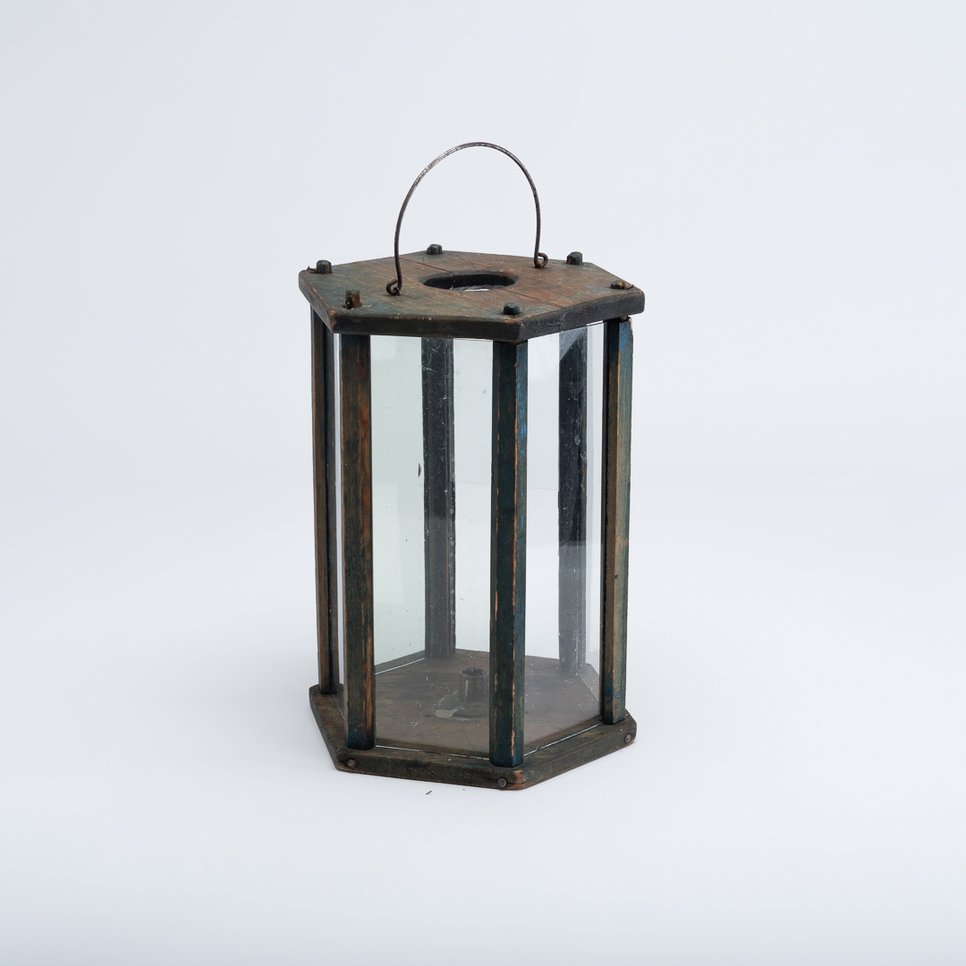Folk art lantern with blue original paint. Brass candle holder in the bottom with room for one candle. Wooden decorations on the top. From northern Sweden