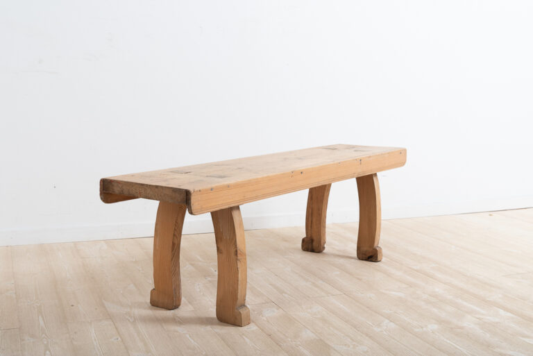 Swedish folk art bench from Hälsingland in northern Sweden. Manufactured from Swedish pine and never painted. Made around 1840.The bench's a genuine antique