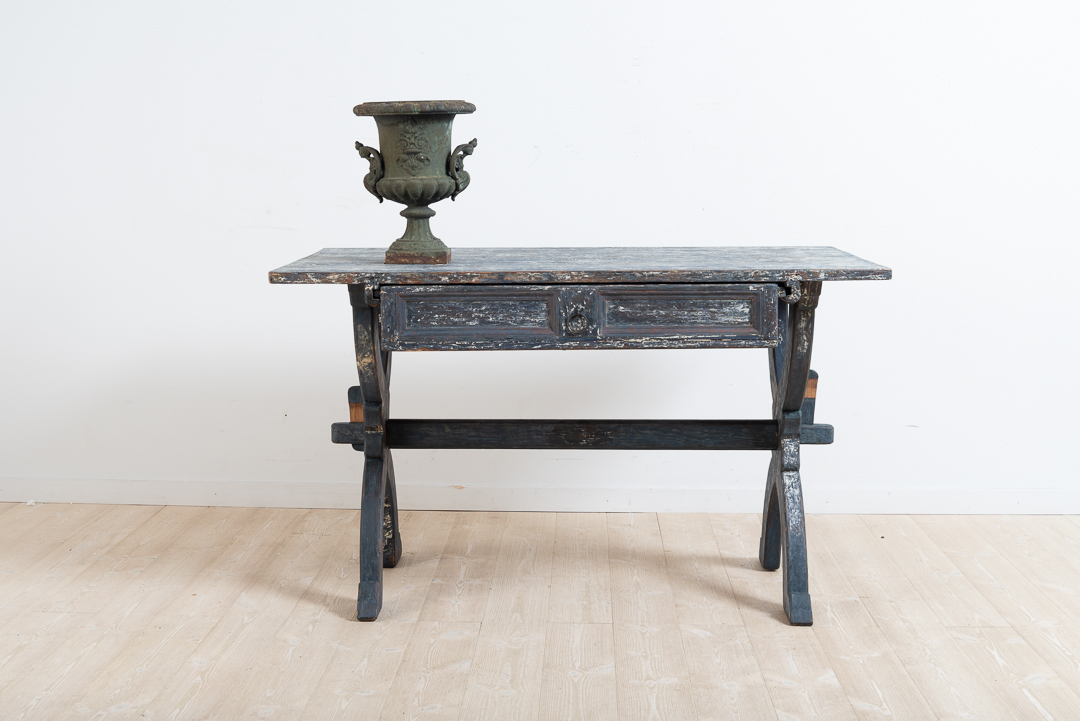 Folk art trestle table with a drawer from northern Sweden. Manufactured drying the late 18th century. Dry scraped to original paint. All parts are original