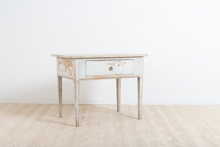 Provincial gustavian coffee table / side table from northern Sweden. Dry scraped to the original first layer of paint. Straight legs with a large drawer. Healthy and solid frame. Manufactured during the late 18th century.