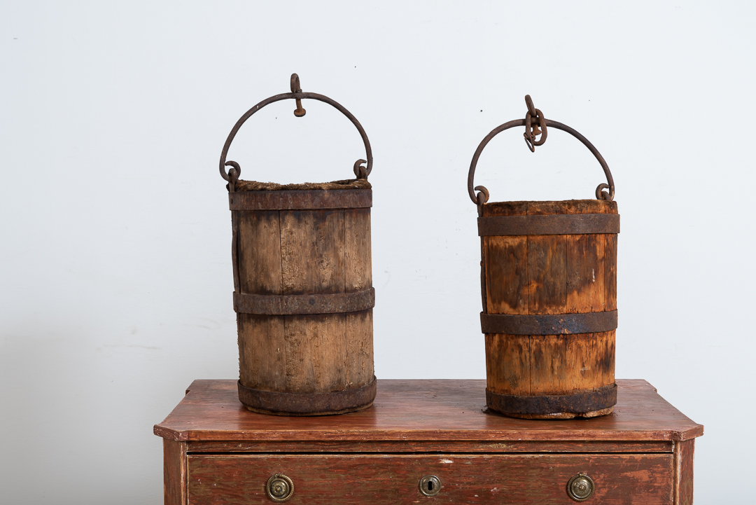 Pair of wooden buckets with sturdy hardware and handle in iron. Manufactured in northern Sweden around the mid 1800s. Natural patina after years of use.