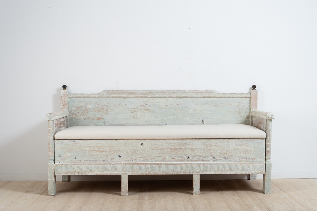 Gustavian provincial sofa from northern Sweden. Hand scraped to the original light blue / green paint. Decorated with carved wooden decor