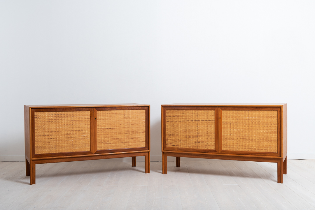 Pair of sideboards in teak by Alf Svensson for Bjästa Snickerifabrik. Doors dressed in rattan. Made around 1960.