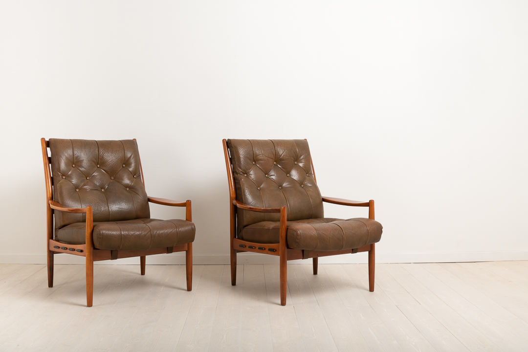 INGEMAR THILLMARK  'Läckö Hög' pair of armchairs. OPE from the 1960s. Frame made from stained beech. Deep padded seats dressed with leather.