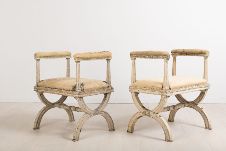 Gustavian stools or banquets by Ephraim Ståhl manufactured in Stockholm. Signed with a cold stamp ES for Ephraim Ståhl, one of Swedens best chairs makers