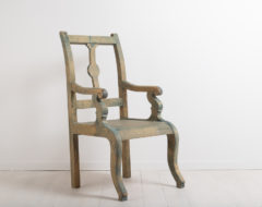 Folk art armchair from northern Sweden. The chair has traces of the original paint. Manufactured around 1870