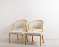 Barrel back chairs in Gustavian Style. Dry scarped by hand. Liberally decorated with wooden carvings, on both front legs and further up along the back
