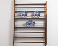 Unusually large plate rack. Folk art wall mounted rack in painted pine. The right side is without paint and slightly rougher as it been against a wall.