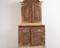 Baroque cabinet from Northern Sweden. Made around 1760. The cabinet has original working lock and traces of original paint. Two parts.