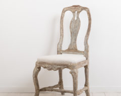 Antique rococo chair from circa 1770. The chair is from northern Sweden.Rustic surface with good patina and traces of the original paint.