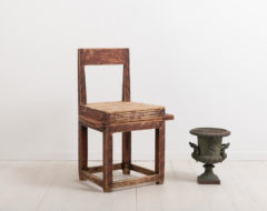Combined folk art chair and table. The furniture is an example of compact living. The goal was to fit as many uses into the same item such as this combined chair and table
