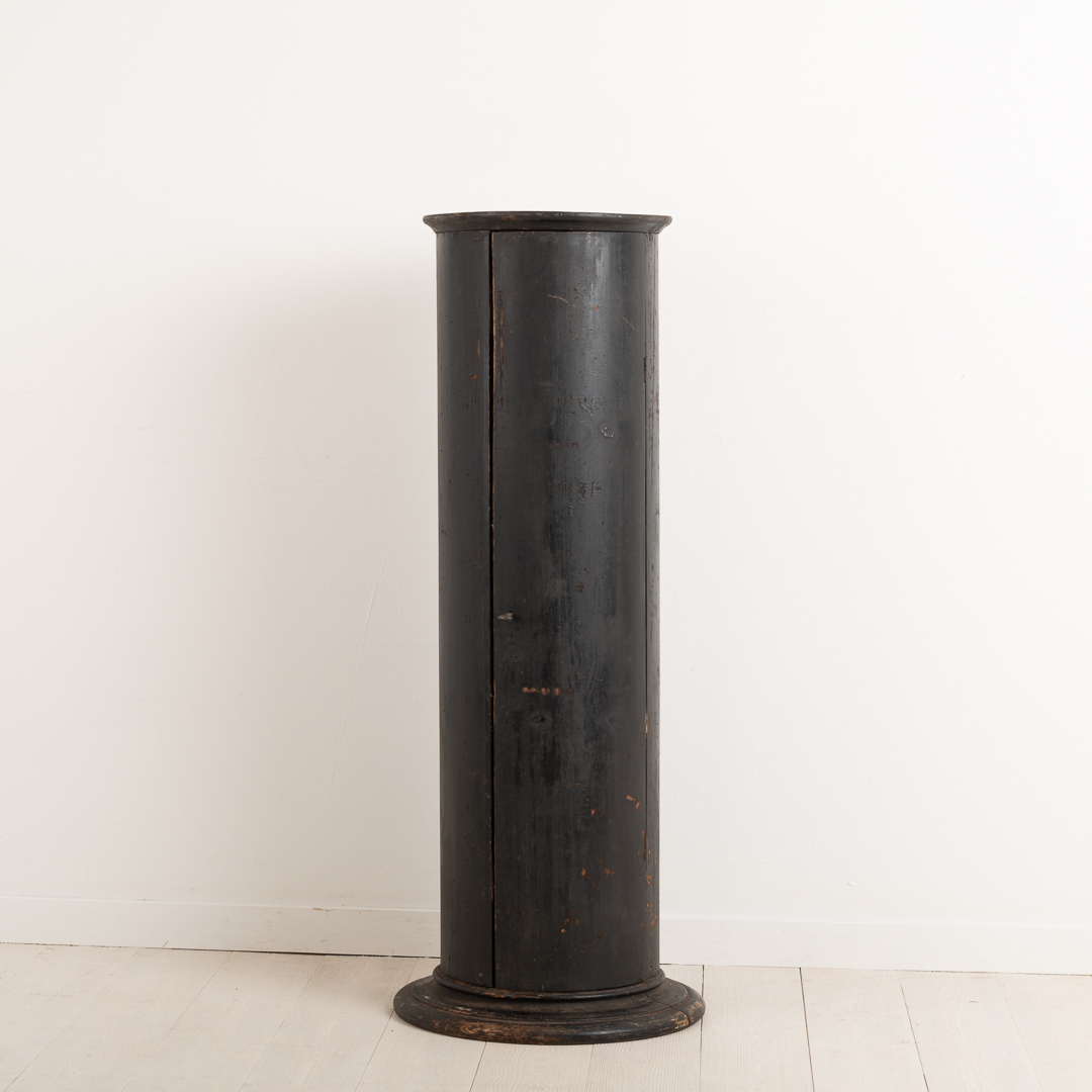 Circular cabinet from norther Sweden. The cabinet is one circular column with a door and three shelves inside. Untouched original condition with the original paint.