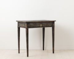 Neoclassical side table from around 1790. The table is from Sweden and has the original lock and distressed paint. Hand carved wooden decorations