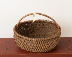 Folk art woven basket from the late 19th century. The basket has some minor signs of wear but is otherwise in good antique condition. For more Miscellaneous