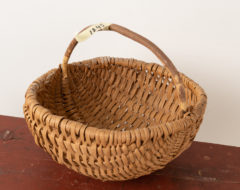 Woven folk art basket from the late 19th century. The basket has some minor signs of wear but is otherwise in good antique condition. For more Miscellaneous