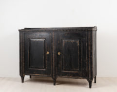 Neoclassical sideboard in painted pine. Unusually decorated with hand carved wooden decorations. Made in northern Sweden around 1790.