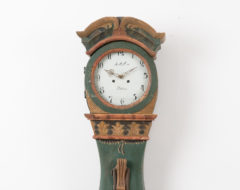 Rococo long case clock in folk art from northern Sweden. The clock is from the province Jämtland. Made around 1780 to 1790 in pine. Old historic paint