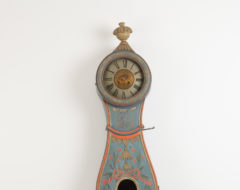 Long case clock from Ljusdal in the province Hälsingland in central Sweden. The case is curved with a rococo shape and decorated with a carved wooden decor