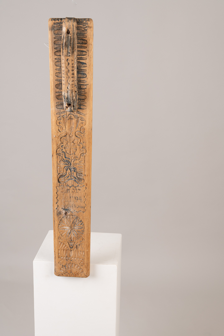 Folk art mangle board from northern Sweden. The rich decorations indicated that the household was very wealthy. Hence they could afford the amount of time