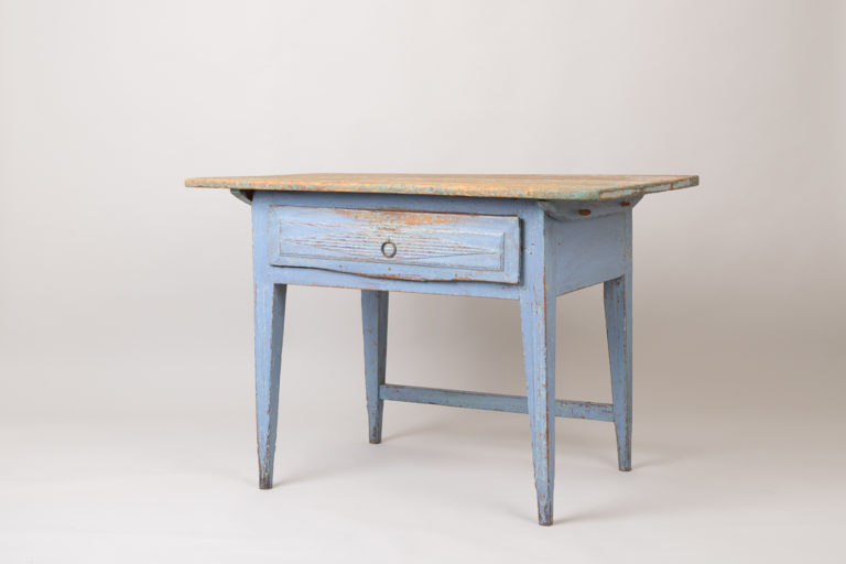 Neoclassical folk art table with original blue paint. Straight tapered legs with fluted decor. Drawer decorated with a diamond shaped ribbed decor.