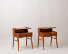 Scandinavian modern teak nightstands from Sweden. The nightstands are a pair and made around 1960. They are in good vintage condition consistent with age and use.