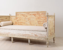 Gustavian sofa in painted pine. It has the original paint with natural distress and wear due to time. Hand carved wooden decor
