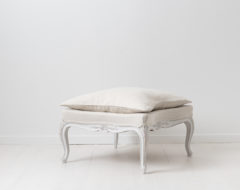 Rococo revival footstool or bench from the late 1800s. The stool is square with an inward or concave curve on all sides. Made in Sweden