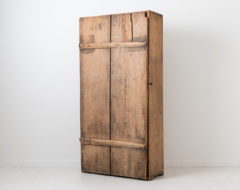 Rustic folk art cabinet made in northern Sweden. The cabinet is unusual and from the late 1700s as well as very primitive. Made from pine
