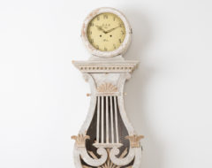 Long case clock in empire style. Made in northern Sweden around 1820 to 1840. Painted pine with distressed old paint. The model is unusual