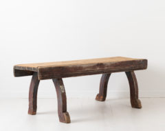 Late 18th century bench in folk art from northern Sweden. The bench is primitive and rustic with original distressed paint and authentic patina