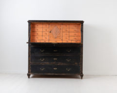 Black neoclassical secretary from northern Sweden. The secretary is from between 1790 and 1800 and has an interior of many small drawers