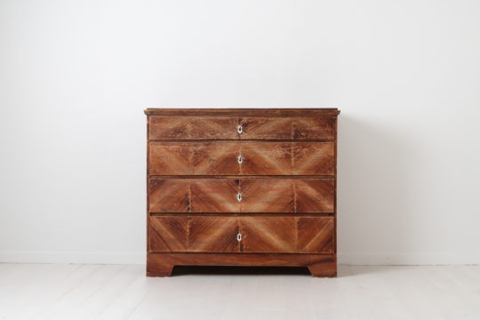Swedish folk art chest of drawers from the mid 1800s. The chest is pine with decorative painting. Distressed paint after 200 years of genuine use