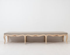 Rococo revival bench from Sweden around 1890. Curved legs with hand carved rosettes and other decoration. The bench is unusually long