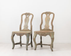 Charming rococo chairs from northern Sweden. The chairs are provincial and folk art with original distressed paint. Made around 1770 with hand carved wooden decor