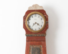 Gustavian long case clock from Northern Sweden made around 1790 to 1800. The clock has a straight shape with original wear and distress. Made in pine.