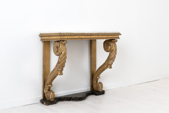 Swedish empire console table from the early 1800s. The table has a bronzed leg frame and a white marble top. Healthy and solid frame