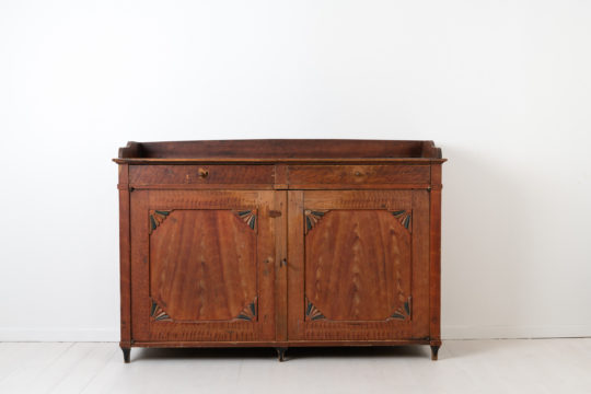 Low red gustavian sideboard from Northern Sweden. The sideboard is from the early 19th century, around 1810 to 1820, and is unusually low and wide