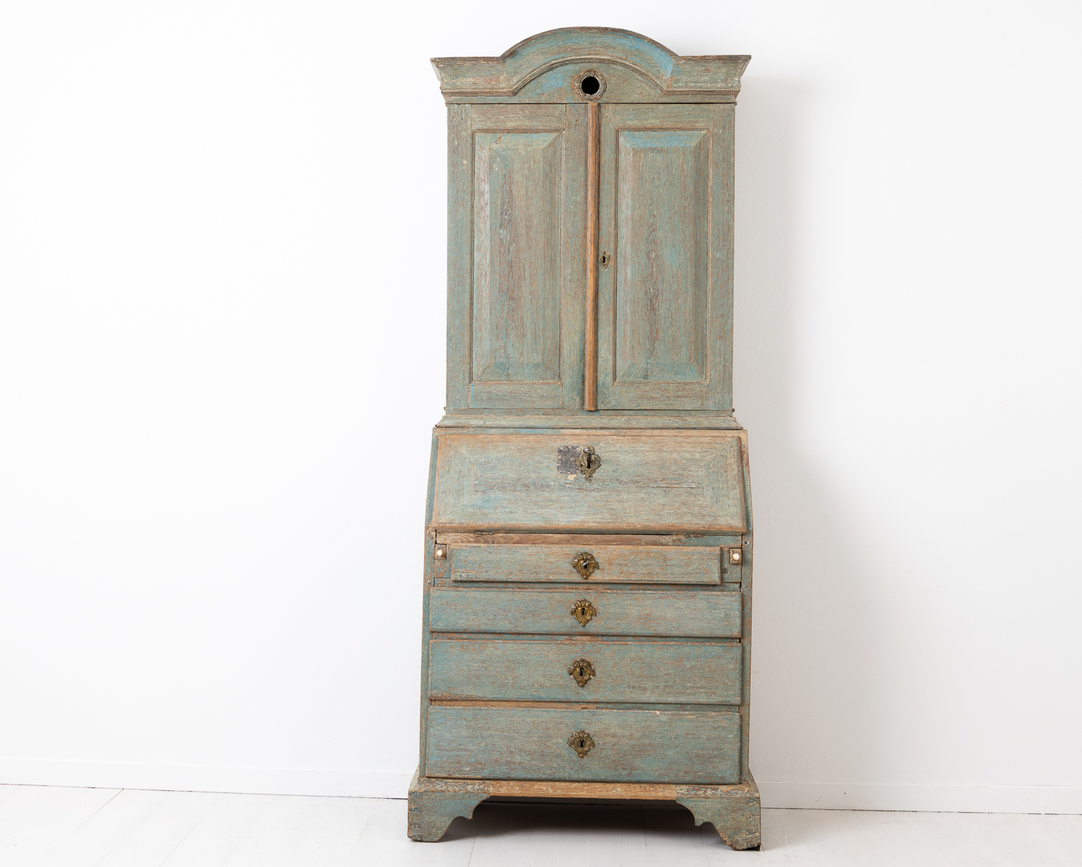 Blue rococo cabinet with desk top from Sweden. The cabinet is from the mid 1700s and made from oak and dry scraped by hand to the original blue paint