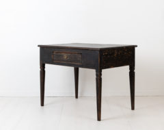 Black side table in gustavian style from the early 1800s. The table is small and neat and would work well even in smaller spaces as a side or wall table