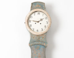 Northern Swedish Mora clock in rococo style with painted pine case made around 1820 to 1830. The blue paint is original from the early 1800s