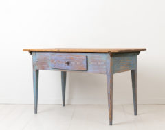 Swedish country table with distressed blue paint from the late 1700s. The table which would work as both a wall or side table is from northern Sweden