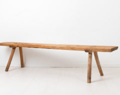 Wide folk art bench in solid pine. The bench is from the early 1800s and has an authentic patina after 200 years of use. The seat is one single board